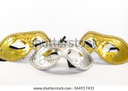 Three carnival masks. Silver and gold