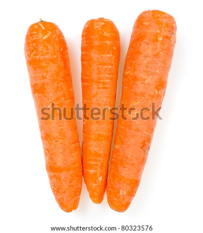 Three carrots isolated on white - stock photo