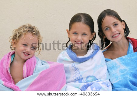 three caucasian sisters with different smiles and expressions on their faces