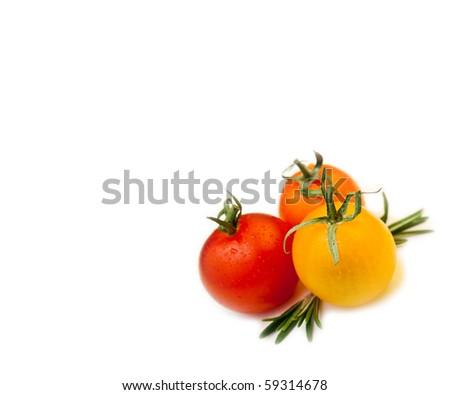 three cherry tomatoes with rosemary on white background - stock photo