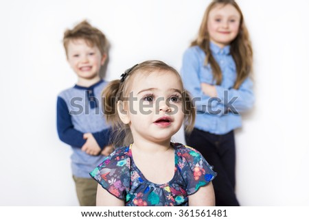 three child close to a wall at home - stock photo