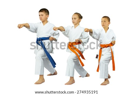 Three children are training punch in the air - stock photo