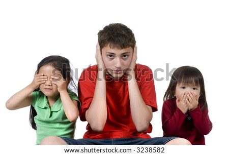 Three children do the old proverb see no evil, speak no evil, see no evil. - stock photo
