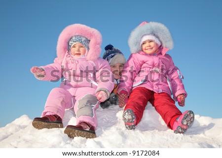 Three children in snow - stock photo