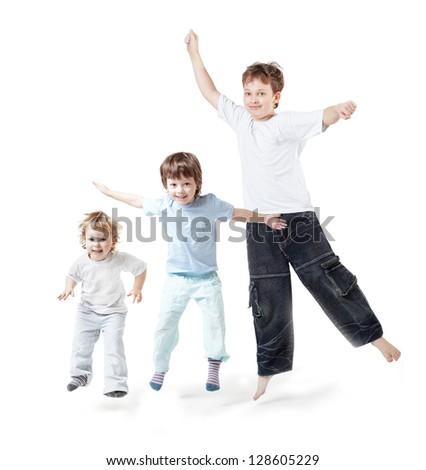 three children jump on white - stock photo