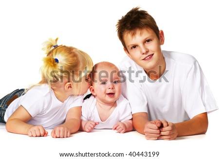 three children lying on floor - stock photo