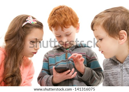 Three children watching child using smartphone. Isolated on white. - stock photo