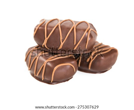 Three chocolate candies isolated on white background - stock photo