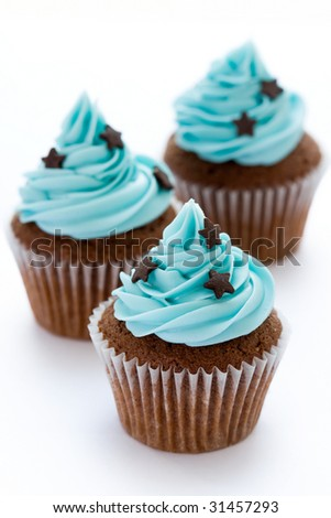 Three chocolate cupcakes in a row - stock photo