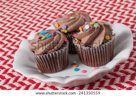chocolate frosting mini chocolate cupcakes with multicolored frosting ...