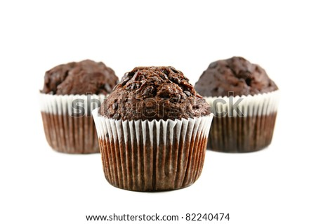 Three chocolate muffins isolated on the white background