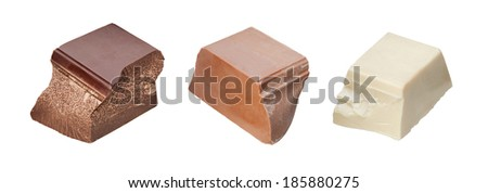 Three chocolate pieces: black, milk and white - stock photo