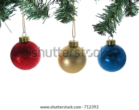 Three christmas ball ornaments with tree branches isolated