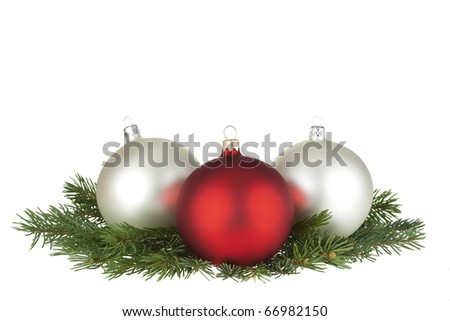 Three Christmas balls and spruce isolated on white. - stock photo