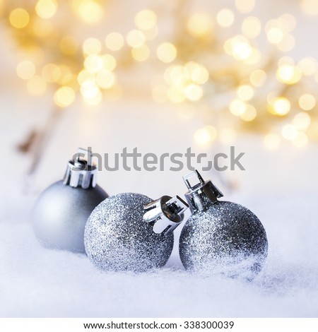 three christmas balls in front of bukeh - stock photo