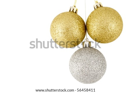 Three christmas balls, two golden, one silver - stock photo