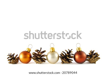 Three christmas balls with cones like a border on the white background - stock photo