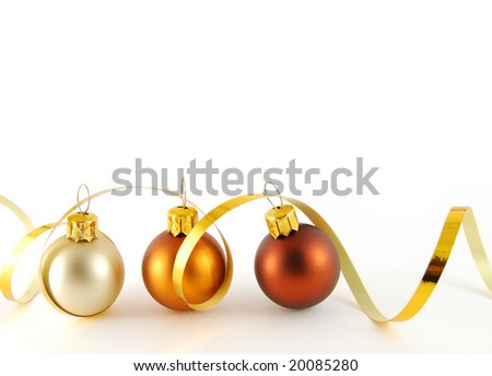 Three christmas balls with gold ribbon on the white background - stock photo