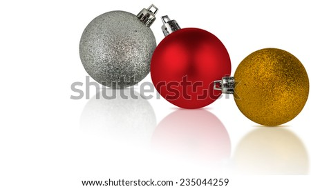 three christmas bauble decorations on white with reflection - stock photo