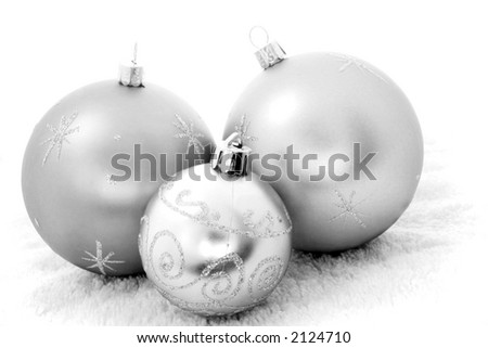 Three Christmas baubles in black and white - stock photo