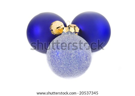 Three Christmas baubles on a white background. - stock photo