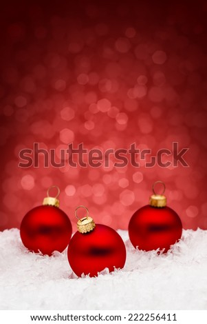Three Christmas Baubles on Red Background - stock photo