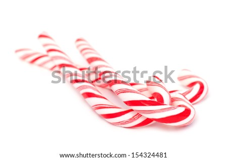 Three christmas candy canes isolated on white, selective focus - stock photo