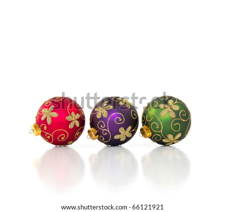 Three Christmas ornaments isolated on a white background