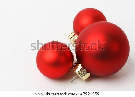 Three Christmas red balls on white background - horizontal  - stock photo