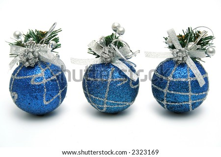 Three christmas spheres of dark blue color with a pattern horizontally - stock photo
