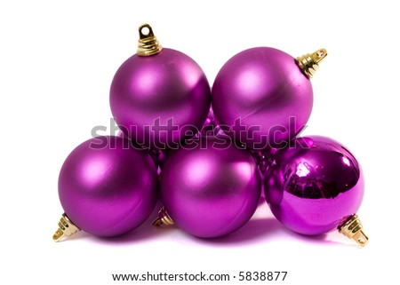 Three christmas spheres on a white background.