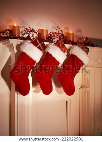 THREE CHRISTMAS STOCKINGS - stock photo