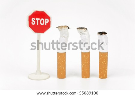 Three cigarette butt and stop sign isolated on a white background - stock photo