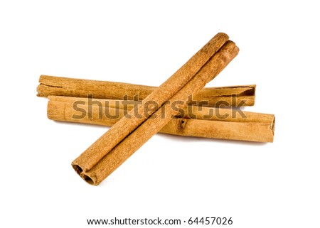three cinnamon sticks isolated on a white background - stock photo