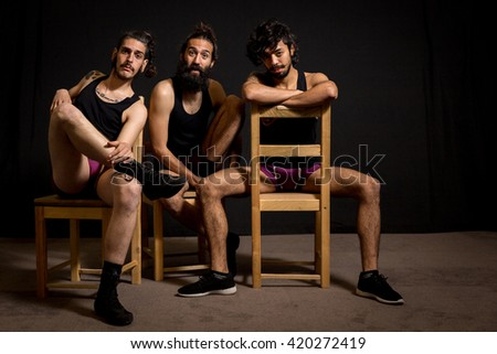 Three circus artists in their comedy performance - stock photo