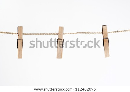 three clamps for laundry hanging on a string