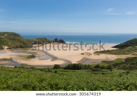 Three Cliffs Bay south coast the Gower Peninsula Swansea Wales uk in summer with blue sea and sky - stock photo