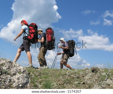 Three climbers - stock photo