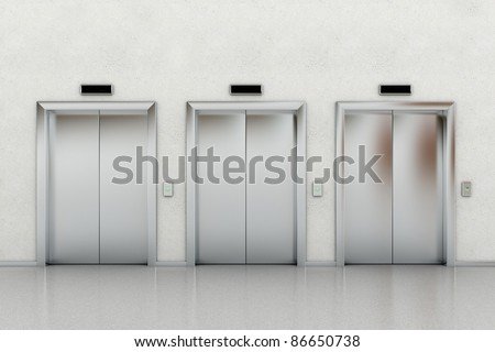 Three closed elevators in a business lobby - stock photo