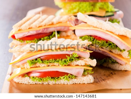 Three club sandwiches on the table  - stock photo