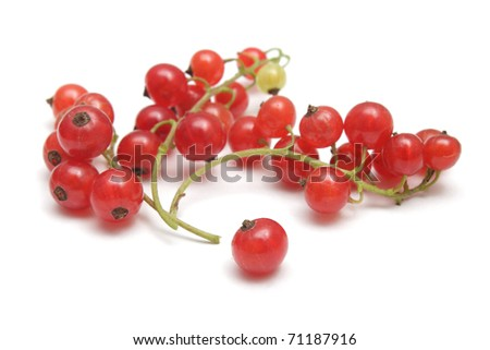 Three clusters of red currant and a single berry isolated on white