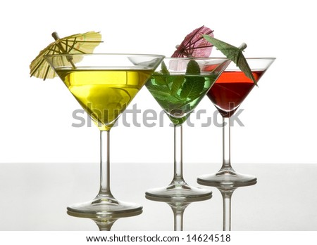 three cocktails with umbrella isolated on white - stock photo