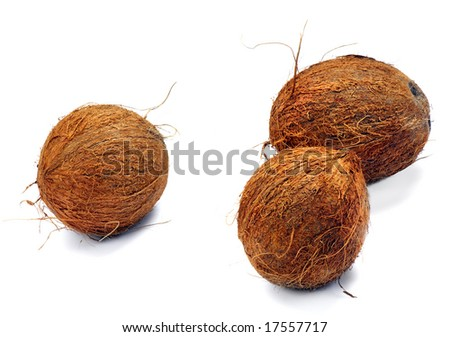 Three coconuts on a white background. Isolated. A close up. - stock photo