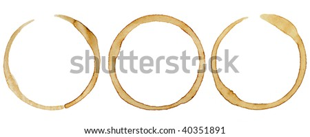 three coffee rings on white - stock photo