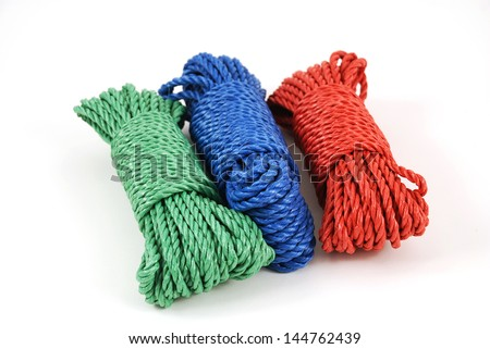three coils of rope in green, blue and red - stock photo
