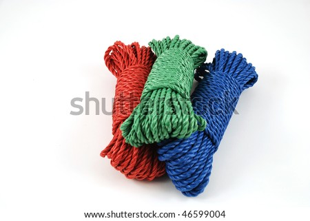 three coils of rope in green, blue and red