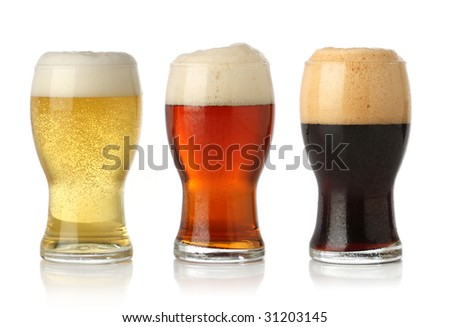 Three cold beer, isolated on white - stock photo