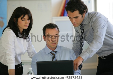 Three colleagues at laptop