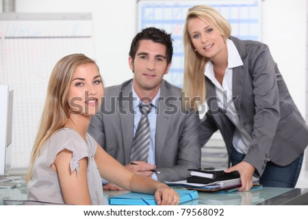 Three colleagues in office - stock photo