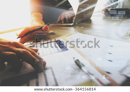 Three colleagues interior designer discussing data stock photo 364156814 shutterstock for Best tablet for interior designers
